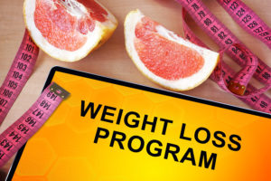 Tablet with weight loss program. Weight loss concept.